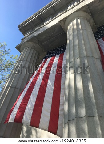A large American flag hangs in front of Grant's Tomb in New York City, USA