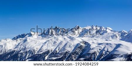 Alps range with Baettlihorn, breithorn, bortelhorn, helsenhorn, monte Cervandone, gross schinhorn, milibach, Switzerland. Viewed from Eggishorn in the Winter (large stitched file) Royalty-Free Stock Photo #1924084259