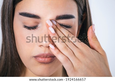 Don't Touch Your Face. Girl rubbing her eye with dirty hands.Precautions, Avoid Touching Your Eyes. Woman rubbing her eye Royalty-Free Stock Photo #1924166657