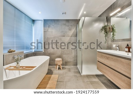 Bright elegant bathroom interior in a luxury house Royalty-Free Stock Photo #1924177559