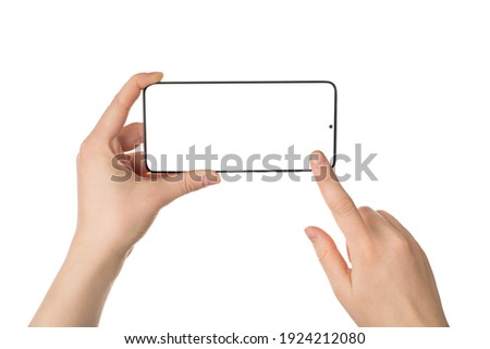 Cropped close up view photo picture of female woman's hands holding telephone in horizontal position touching screen isolated white backdrop Royalty-Free Stock Photo #1924212080