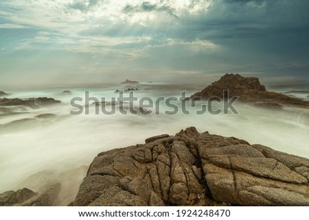 Long exposure water, beautiful seascape, ocean views, rocky coastline, sunlight, on the horizon. Composition of nature. Sunset scenery background. Cloudy sky. California coast. Royalty-Free Stock Photo #1924248470