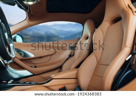 Modern supercar interior with leather panel, sport seats, multimedia and digital dashboard Royalty-Free Stock Photo #1924368383
