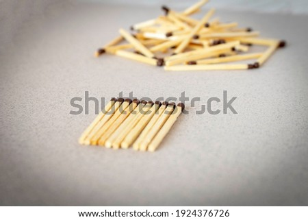 Lots of matches on a light background. The concept of chaos and order. Selective focus Royalty-Free Stock Photo #1924376726