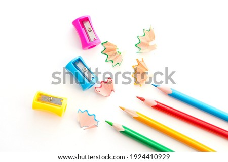 colored pencils and colored pencil sharpeners, isolated on white background.