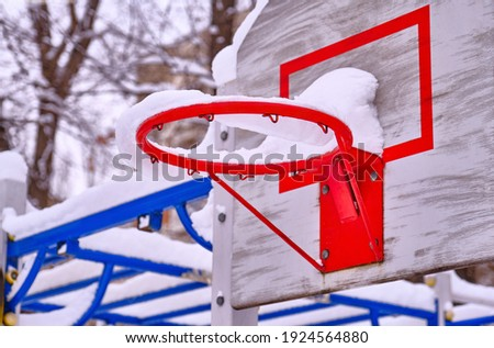 Basket for playing basketball on the playground in the winter season