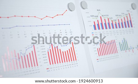 Close up diagram infographic on flip chart whiteboard. Presentation strategy business financial marketing plan achieving targets company Royalty-Free Stock Photo #1924600913