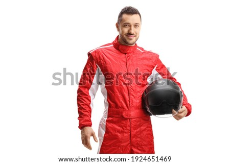 Man racer in a red uniform holding a helmet and smiling isolated on white background Royalty-Free Stock Photo #1924651469