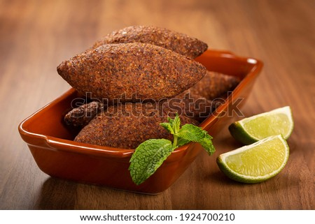 Kibbeh - The traditional Arabian snack, known in Brazil as Quibe. Royalty-Free Stock Photo #1924700210
