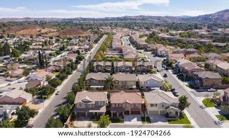 Daytime aerial view of a high density suburban neighborhood in Riverside, California, USA. Royalty-Free Stock Photo #1924704266