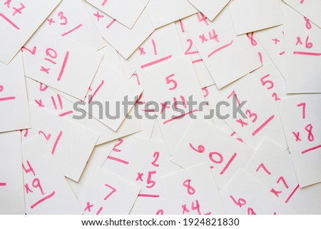 Multiplication flash cards spilled onto a pile; scattered math flash cards background Royalty-Free Stock Photo #1924821830
