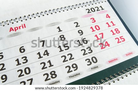 April 2021 paper calendar planner with spiral, close-up. Royalty-Free Stock Photo #1924829378
