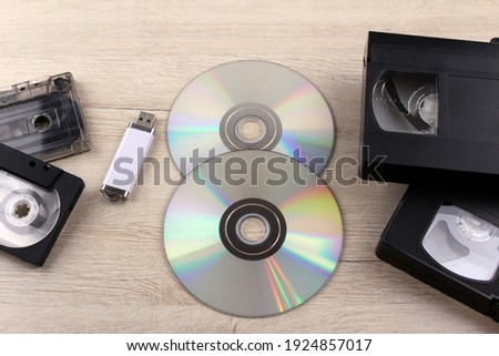 Audio cassettes, videotapes, disks and flash drives. Recording media of different generations