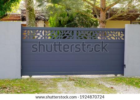 Aluminum gate sliding modern design grey portal of suburb garden door slide house Royalty-Free Stock Photo #1924870724