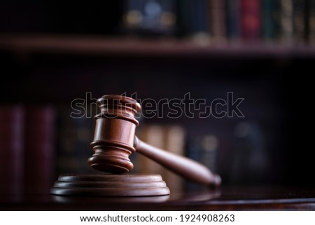 Judge's gavel on book background. Justice concept.