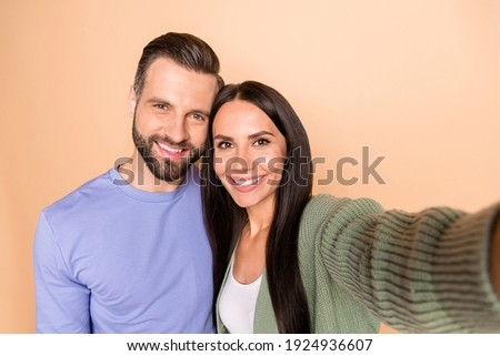 Photo of optimistic nice couple do selfie wear sweater isolated on beige color background