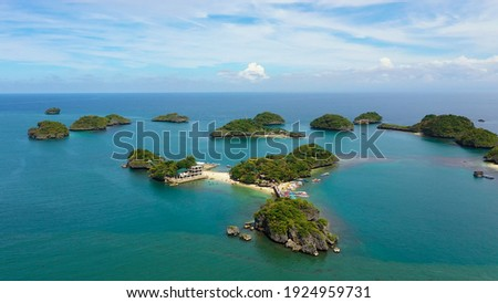 Aerial view of Small islands with beaches and lagoons in Hundred Islands National Park, Pangasinan, Philippines. Famous tourist attraction, Alaminos. Royalty-Free Stock Photo #1924959731