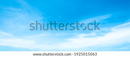 Blue sky and white clouds floated in the sky on a clear day with warm sunshine combined with cool breeze blowing against the body resulting in a miraculous refreshing like paradise. Royalty-Free Stock Photo #1925015063