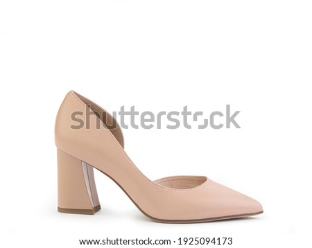 Classic and elegant high-heeled women shoes. Stylish beige shoes on high block heels and with a pointed toe. Isolated object close up on white background. Right side view. Fashion shoes. Royalty-Free Stock Photo #1925094173
