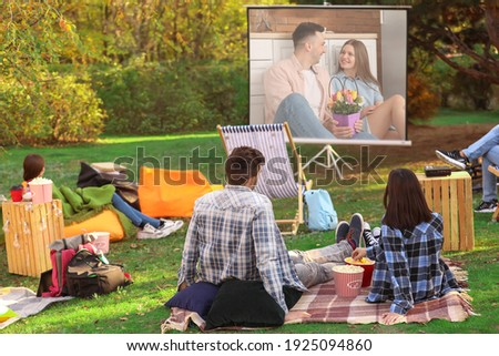 Friends watching movie in outdoor cinema Royalty-Free Stock Photo #1925094860