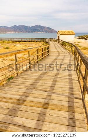 Isla Plana town, promenade walking area on sea shore, Mazarron Murcia Spain. Tourist place. Royalty-Free Stock Photo #1925275139