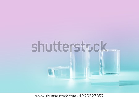 Acrylic empty podium for product presentation on nein pink and blue colored background, transparent geometric pedestals Royalty-Free Stock Photo #1925327357