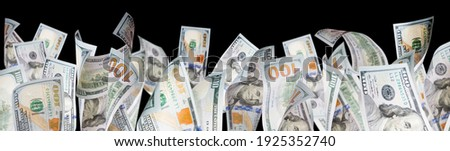 Several One Hundred Dollar Bills Falling At Base of Black Page. Royalty-Free Stock Photo #1925352740