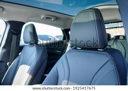 Luxury leather headrest and seats in a new car Royalty-Free Stock Photo #1925417675