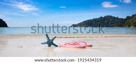 Panorama view with   flip-flop sandals on the beach ,summer vacation, travel Concept Royalty-Free Stock Photo #1925434319