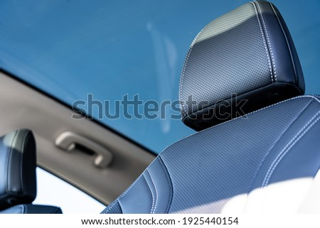 Luxury leather Upholstry on headrest in a new car Royalty-Free Stock Photo #1925440154