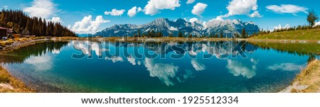High resolution stitched panorama of a beautiful alpine summer view with reflections in a lake at the famous Astberg summit, Going, Wilder Kaiser, Tyrol, Austria Royalty-Free Stock Photo #1925512334