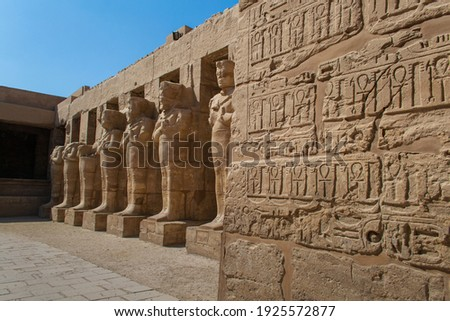 KARNAK TEMPLE - Massive columns inside beautiful Egyptian landmark with hieroglyphics, and ancient symbols. Famous landmark in the world near the Nile River and Luxor, Egypt Royalty-Free Stock Photo #1925572877