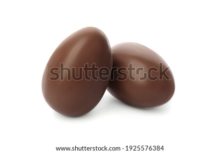 Two sweet chocolate eggs on white background Royalty-Free Stock Photo #1925576384