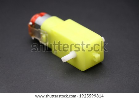 BO Motor also called as dual shaft geared motor on black background. Double shaft DC Geared motor used in robotic and electronic projects Royalty-Free Stock Photo #1925599814