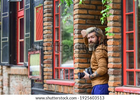 inspiration. photography in modern life. travel tips. professional photographer use vintage camera. bearded man hipster take photo. photo shooting outdoor. brutal man traveler with retro camera.