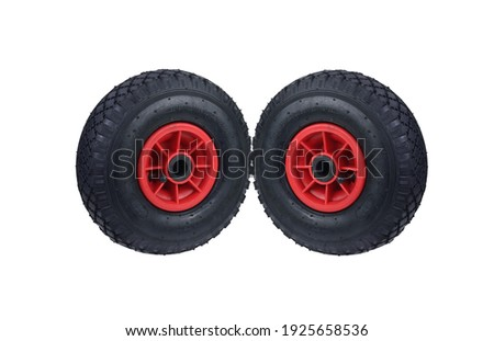 Handcart wheels on white isolated Royalty-Free Stock Photo #1925658536