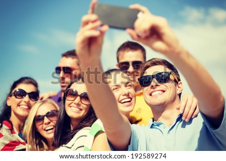 summer, holidays, vacation and happiness concept - group of friends taking selfie with smartphone #192589274