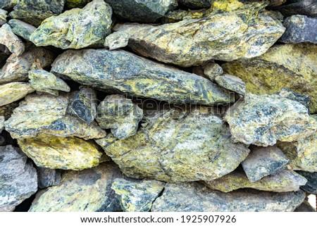 Jadeite stone masonry, natural rubble stone texture and jadeite rubble stone background Royalty-Free Stock Photo #1925907926