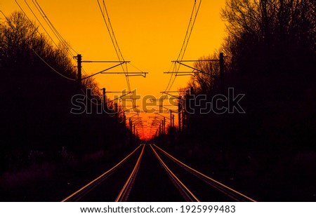 Sunset forest railway road view. Sunset railway view. Sunset railway road. Railway in sunset time Royalty-Free Stock Photo #1925999483