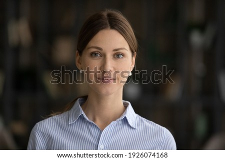 Profile picture of young Caucasian confident woman employee or worker pose at workplace in office. Headshot portrait of happy millennial successful European businesswoman. Leadership concept.