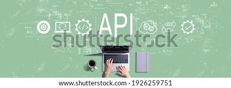 API - application programming interface concept with person working with a laptop