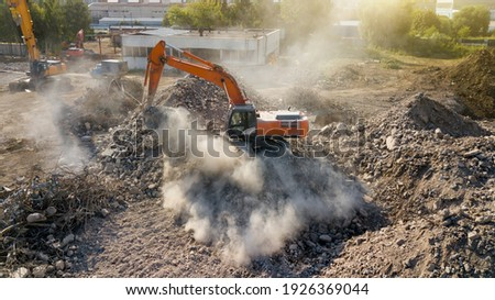 Excavator demolish building. View from above Royalty-Free Stock Photo #1926369044