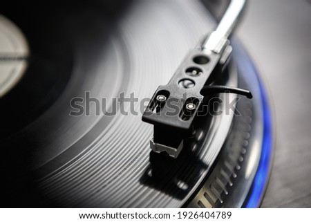 Retro dj turntable player device on stage in nightclub.Download royalty free curated images collection with dj music for design template.