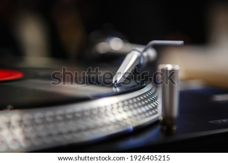 Vintage dj turntable player on stage in nightclub.Professional disc jockey turn table device playing analog records.Download royalty free curated images collection with dj music for design template
