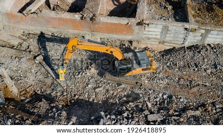 Excavator demolish building. Aerial view. Royalty-Free Stock Photo #1926418895