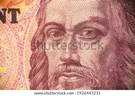 Close-up macro photo of the Hungarian 10,000 forint banknote. The banknote shows a portrait of Saint István King. Bank image and photo. Royalty-Free Stock Photo #1926443231