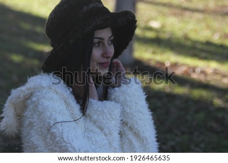 Middle Eastern girl in a park Royalty-Free Stock Photo #1926465635