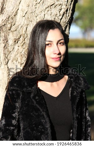 Middle Eastern girl in a park Royalty-Free Stock Photo #1926465836