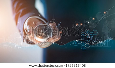 Abstract, Businessman holding compass of navigate on global economic crisis to resume business growth, Rethink, Reinvent and Recover. on graph growth background. Royalty-Free Stock Photo #1926515408