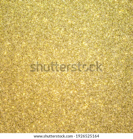 Gold glitter texture background sparkling shiny wrapping paper for Christmas holiday seasonal wallpaper  decoration, greeting and wedding invitation card design element Royalty-Free Stock Photo #1926525164
